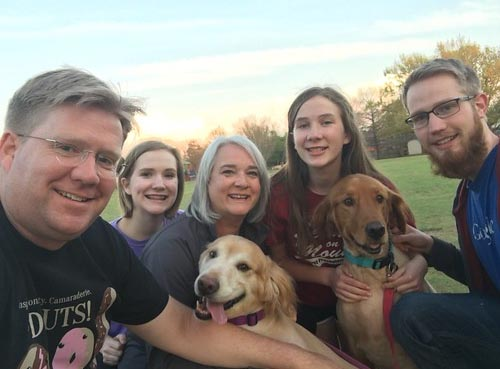 image of a family with their 2 dogs